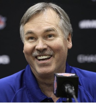 New York Knicks head coach Mike D'Antoni resigned today amid a disappointing season and a torrid losing streak, during which insiders claim 'he had lost control of the locker room.' D'Antoni, however, has already landed on his feet by being named General Manager of a Chick Fil-A franchise in Syosset, NJ, for which his appearance is perfectly suited. 'We are going to work very hard on our drive-thru service speed and accuracy,' D'Antoni promised. (Associated Press)