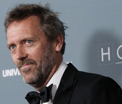 Cast member Hugh Laurie poses as he arrives at the series finale wrap party of the television series 'House M.D.' in Los Angeles, California April 20, 2012. 'I look forward to shaving regularly,' Laurie said, 'as I find the American's preoccupation with stubble both reprehensible and ridiculous--have a beard or don't.'  (Associated Press)