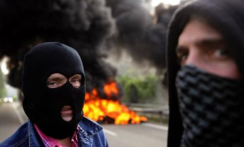 Self-proclaimed superheroes 'ArsonMan,' left, and 'Mr Arson,' right, are shown leaving the scene of a tire fire they set outside Huntington, WV, recently. 'We want to be known as The Arson Brothers and we want people to know we are fully capable of burning anything that they need burnt,' stated ArsonMan, 'even if might upset environmentalists, insurance companies, and law enforcement agencies.' Mr Arson concurred, 'Some stuff just needs to get burninated.' (Associated Press)