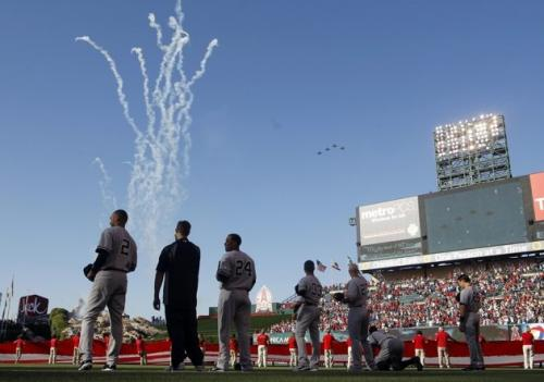 Members of the New York Yankees ignore a predictably futile attempt by Cuban nationalists to down a US Air Force flyover before a recent game against the Angels. (Associated Press)