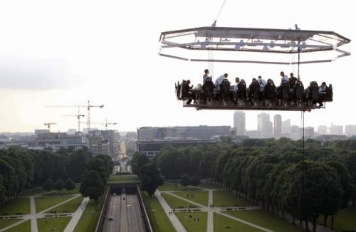 With office space at a premium in Brussels, Belgium, companies have begun having meetings on platforms suspended in midair. 'The privacy is a welcome bonus,' stated Jurgaard Svenson, an administrative assistant who uses the meeting space for his telecommunications company, 'but we occasionally have those who lean back too far.' (REUTERS)
