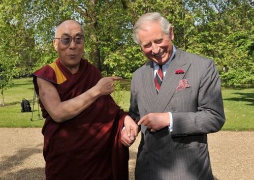 Tibet's exiled spiritual leader the Dalai Lama completes a 'Wet Willie' on Britain's Prince Charles at Clarence House in central London June 20, 2012. 'That man is a bit toodles,' the Prince stated. (REUTERS)