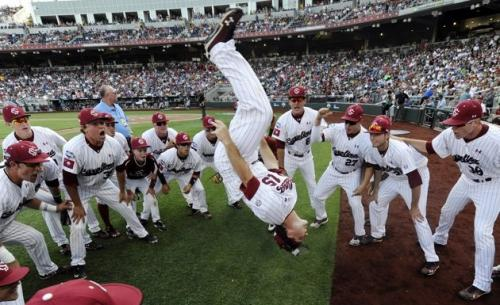 University of South Carolina teammates watch in horror as teammate Nolan Belcher plunges to the ground from the upper deck before Game 2 of the NCAA College World Series baseball finals against Arizona, in Omaha, Nebraska. The senior had gone into the stands to sign autographs and would have been late returning to the field for the starting lineups, so he jumped. 'I thought I would land on my feet,' Belcher stated. He missed the game due to a severe headache. (Associated Press)
