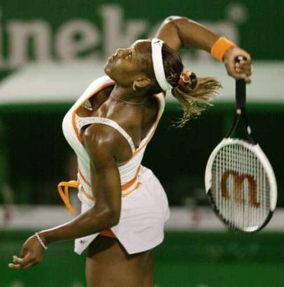 Serena Williams lofts three objects high into the air during her service game to sister Venus Williams. Serena went on to win the match and capture the Australian Open.