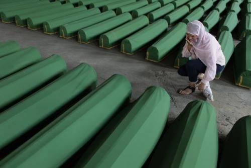 A Bosnian woman in a tent factory near Srebrenica performs a quality check on eight-man tents before they are shipped to US stores. Camping and camping supplies sales are one of the few bright spots in a dingy economy as the public looks for ways to vacation more cheaply. (Associated Press)