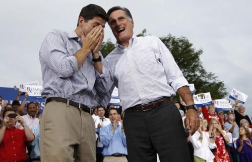 Mitt Romney laughs it up following a searing fart that watered the eyes of his running mate, Paul Ryan, during a campaign stop in Waukesha, WI. 'Wow,' Ryan would say later, 'when he eats a whole bag of salt and vinegar potato chips, he seems powerful enough to get this thing back on track.'  (Associated Press)