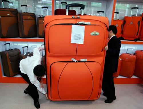 A Chinese company has constructed a new line of massive suitcases for use specifically during air travel. Chinese airlines have limited passengers to one piece of luggage per party, rather than one per person as in all other countries, but have never placed constraints on the size of the piece. 'It big for big vacation,' said Zue Zhan Zhi, a company representative. (REUTERS)