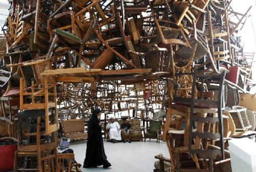 The 2014 Hoarding Olympic Games will be held in Des Moines, Iowa, it was announced today. Majaresh Punti, of Brooklyn, NY, seated left, will be competing in the wooden chairs competition. 'I like, and I have always liked, wooden chairs,' he said. (Associated Press)
