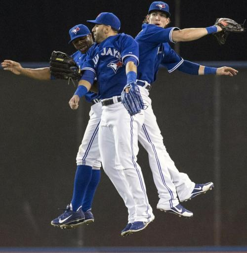 Toronto Blue Jays' Rajai Davis, left, Jose Bautista, center, and Colby Rasmus collide while trying to catch a high pop-fly during their 4-2 win over the Baltimore Orioles in Toronto. (REUTERS)