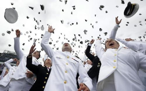 Members of the United States Naval Academy are victimized by a surprise hat attack in Annapolis. 'We were just meeting to discuss our afternoon plans for a group picnic and suddenly hats began dropping from the sky,' stated Corporal Lance Stutzman. An al qaeda group later claimed responsibility. No one was injured, but it did take almost twenty minutes to clean up. (AP Photo/Pablo Martinez Monsivais)