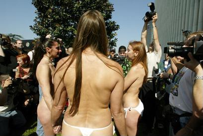 Three nude women gathered in a Los Angeles park yesterday to protest something.  Police were not called for nearly thirty minutes and few onlookers were aware of the cause for the demonstration, including Charlie Sheen.  None of the women were arrested, however, though all were taken into custody for questioning. (Associated Press)