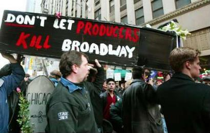 Broadway musicians and actors carry a coffin and chant as they march during a rally in New York's Times Square, March 8, 2003. The musicians are on strike against Broadway producers over the new maximum size of the orchestras for each play, which has been set at four feet, six inches tall.  (Associated Press)