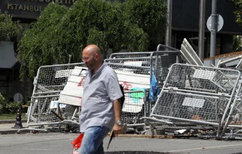 A man passes walks past a barricade of hundreds of discarded futon frames after the fifth day of clashes in Istanbul. Daily life is partly back to normal after days of intense clashes between thousands of angry protesters and riot police as a demand for more comfortable sleeper-style furniture was taken to the streets for the third time in a decade. (AP Photo/Thanassis Stavrakis)